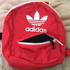 Mini Adidas red backpack.